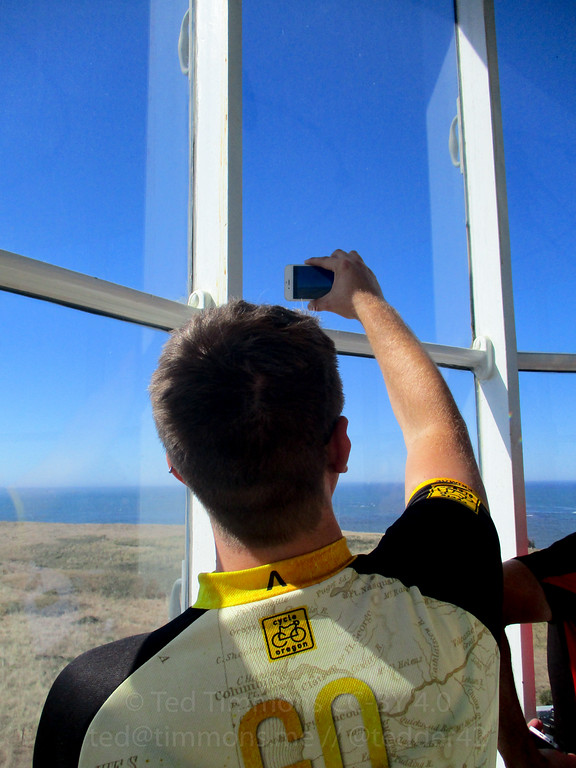 Picture of Jeremy taking a picture from the top of the lighthouse.