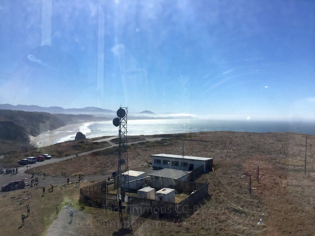 Looking south from the Cape Blanco lighthouse. Literally at the light; notice the reflection towards the right of the glass Fresnel lens.