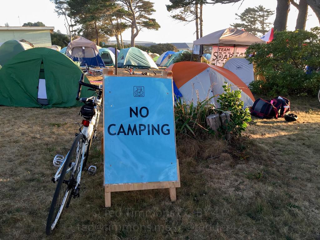 Camping at the NO CAMPING sign.