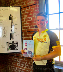 Jeremy in the lighthouse, with a book about lighthouse cats.