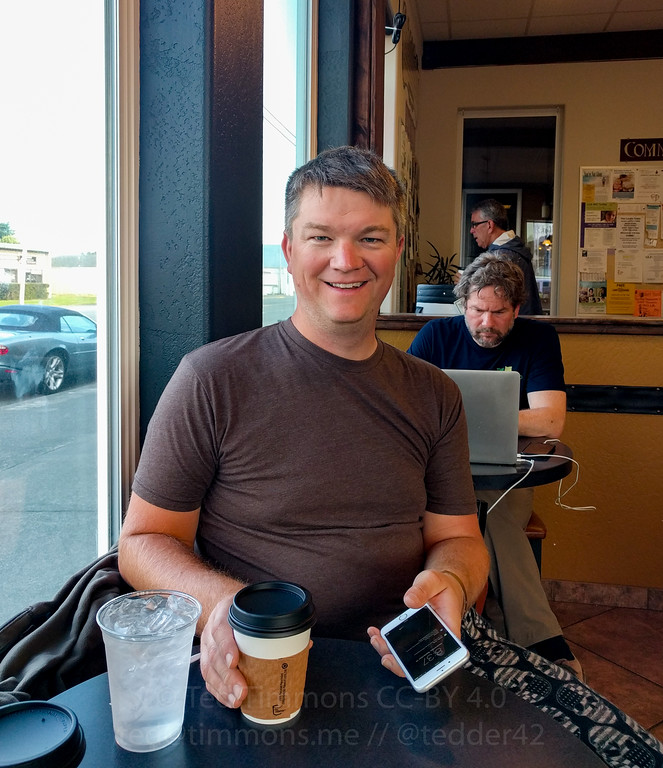 Jeremy at Rachel's Coffee House. Hilariously grumpypants dude behind him.