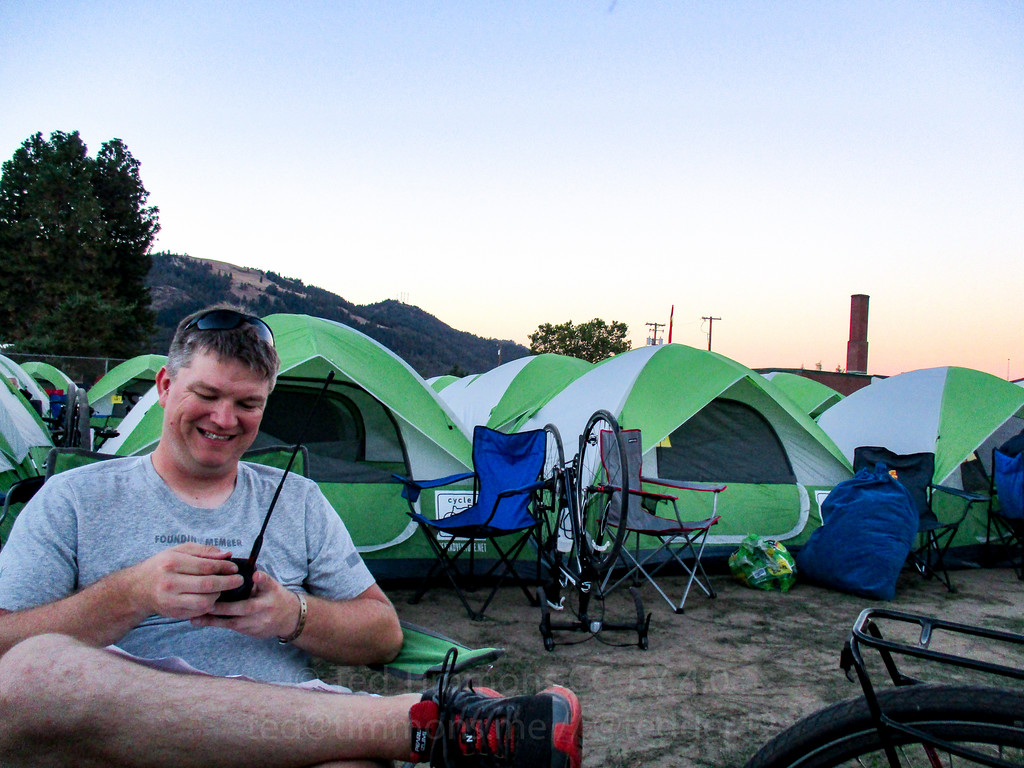 Jeremy, programming his radio at sunset.