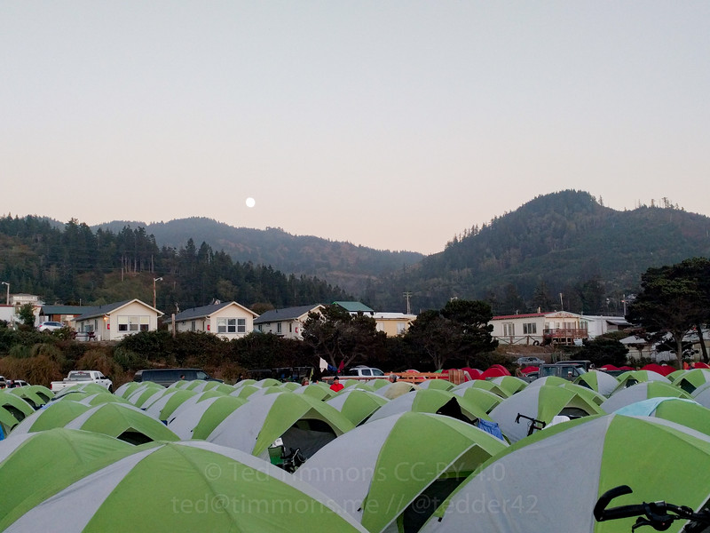Rising moon and setting sun over camp in Gold Beach.