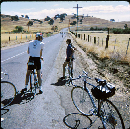 People: guy, gal, pack of 6<br /> Subject: country roads<br /> Place: Brentwood<br /> Activity: GPP ride<br /> Comments: Not Danimal. I asked. No cars. Could ride all over the road. Huge saddle bag.<br /> 5*Sat, Sep 25, 1971