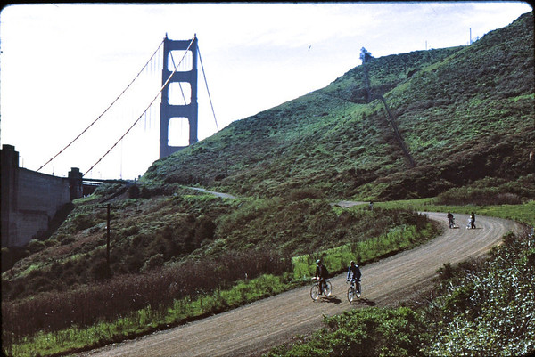 People: 4 cyclists<br /> Subject: <br /> Place: dirt road from bridge<br /> Activity: GPP ride SF to Marin<br /> Comments: the guy in the Tam O'Shanter is Charles Larribeau, Pres of GPP in 1974<br /> 5*Sun, Mar 28, 1971