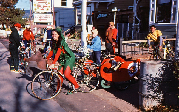 People: Patty, Charles, Monte Lee<br /> Subject: xmas ride<br /> Place: the factory, alameda<br /> Activity: Patty Rose Xmas ride<br /> Comments: reindeer head on bike<br /> 4*Sun, Dec 22, 1974