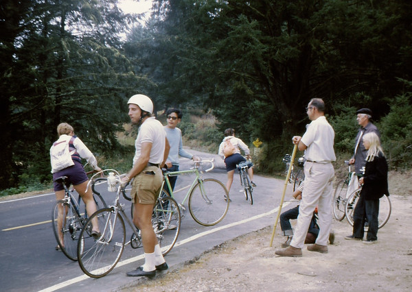 People: 4 GPP cyclists<br /> Subject: <br /> Place: top of hill to Limantour<br /> Activity: GPP Pt Reyes ride<br /> Comments: don't recognize any.  Only other rider with helmet (rock climbing?) Hikers looking at strange site (back in 1973)<br /> 4*Sat, Mar 24, 1973