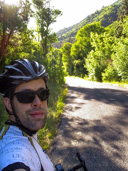 Selfie alongside the road. Very green.