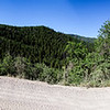 Panorama along the gravel climb. Some really pretty mountains- the ones at the right have snow.