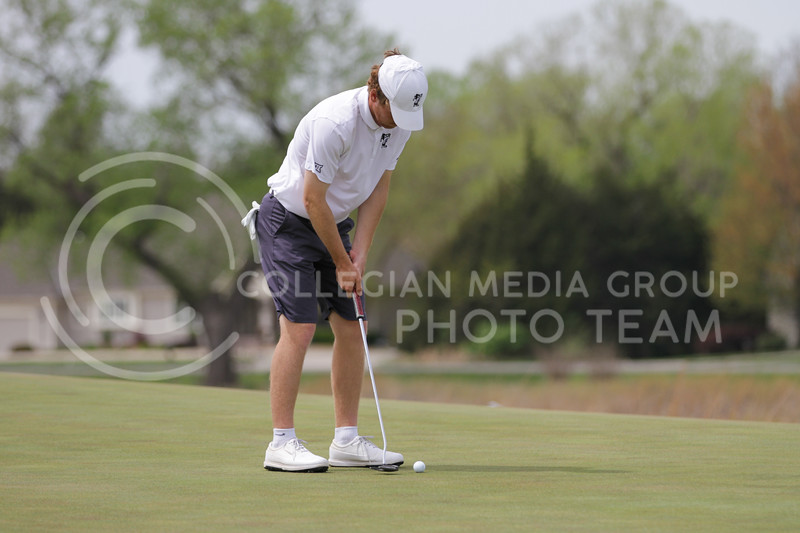 Jacob Eklund prepares to swing during the first round of the Big 12 Golf Championship at Prairie Dunes Country Club on April 26, 2021. (Sophie Osborn   Collegian Media Group)