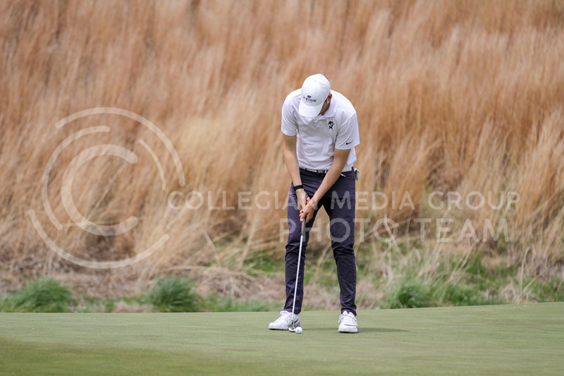 Tim Tillmanns readies to hit the ball during the first round of the Big 12 Golf Championship at Prairie Dunes Country Club on April 26, 2021. (Sophie Osborn   Collegian Media Group)