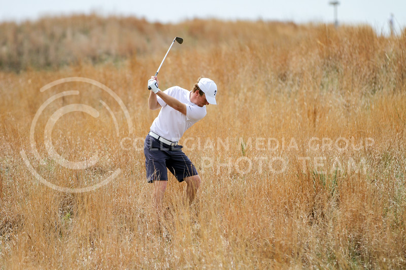 Jacob Eklund swings in hopes of getting the ball back onto the greens during the first round of the Big 12 Golf Championship at Prairie Dunes Country Club on April 26, 2021. (Sophie Osborn   Collegian Media Group)
