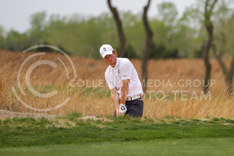 Jacob Eklund looks onto the course while his ball is stuck in the sand during the first round of the Big 12 Golf Championship at Prairie Dunes Country Club on April 26, 2021. (Sophie Osborn   Collegian Media Group)