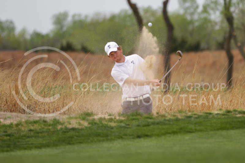 Jacob Eklund hits his ball out of the sand during the first round of the Big 12 Golf Championship at Prairie Dunes Country Club on April 26, 2021. (Sophie Osborn   Collegian Media Group)