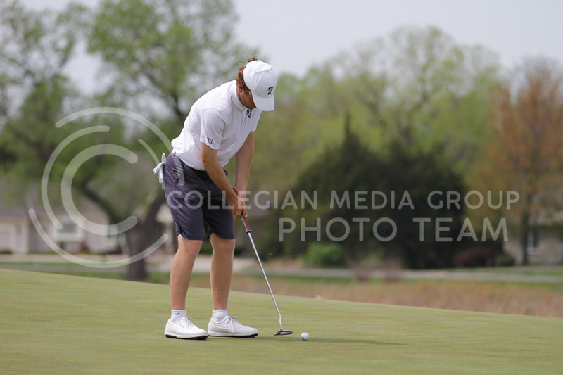 Jacob Eklund prepares to hit the ball during the first round of the Big 12 Golf Championship at Prairie Dunes Country Club on April 26, 2021. (Sophie Osborn   Collegian Media Group)