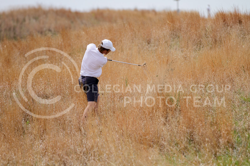 Jacob Eklund uproots some grass in attempts to hit the ball back onto the greens during the first round of the Big 12 Golf Championship at Prairie Dunes Country Club on April 26, 2021. (Sophie Osborn   Collegian Media Group)
