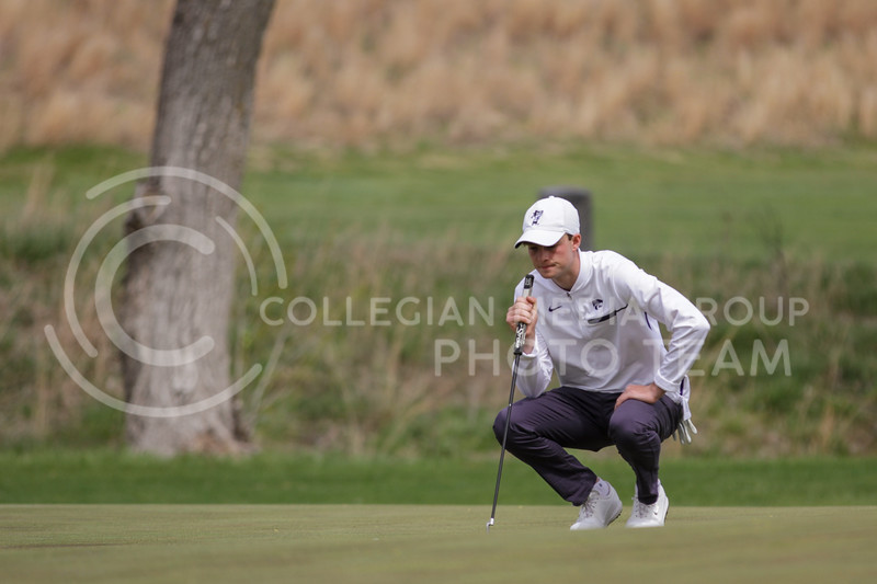 Luke O'Neill eyes the course during the first round of the Big 12 Golf Championship at Prairie Dunes Country Club on April 26, 2021. (Sophie Osborn   Collegian Media Group)