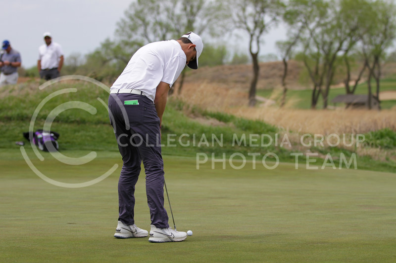 Will Hopkins looks toward the hole during the first round of the Big 12 Golf Championship at Prairie Dunes Country Club on April 26, 2021. (Sophie Osborn   Collegian Media Group)