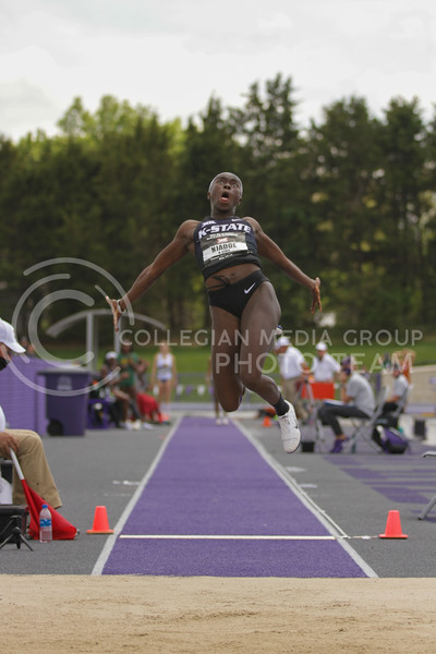 Senior Wurrie Njadoe jumps during the second day of the Big 12 Track and Field Championships at R.V Christian Track. (Sophie Osborn | Collegian Media Group)