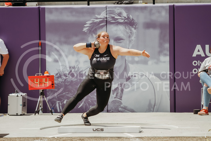 Junior Taylor Latimer gets ready to throw shotput during the second day of the Big 12 Track and Field Championships at R.V Christian Track. (Sophie Osborn | Collegian Media Group)