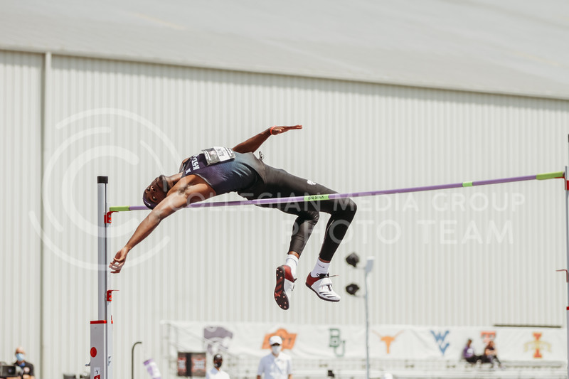 Senior Kyle Alcine arches over the high jump bar during the second day of the Big 12 Track and Field Championships at R.V Christian Track. (Sophie Osborn | Collegian Media Group)