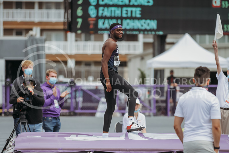Senior Kyle Alcine stands after clearing the high jump bar during the second day of the Big 12 Track and Field Championships at R.V Christian Track. (Sophie Osborn | Collegian Media Group)