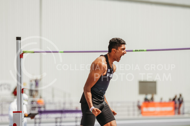 Senior Tejaswin Shankar celebrates clearing the winning height during the second day of the Big 12 Track and Field Championships at R.V Christian Track. (Sophie Osborn | Collegian Media Group)