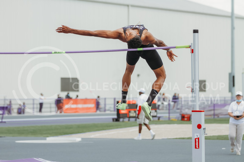 Senior Tejaswin Shankar arches over the high jump bar during the second day of the Big 12 Track and Field Championships at R.V Christian Track. (Sophie Osborn | Collegian Media Group)