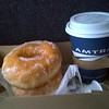 CUP OF COFFEE AND EARLY MORNING DOUGHNUT.