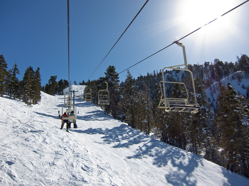 On the Silver Mountain chair lift, looking up Exhibition ski run