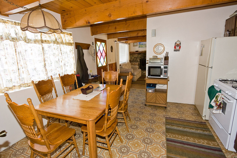 The kitchen looking toward the front door and living room