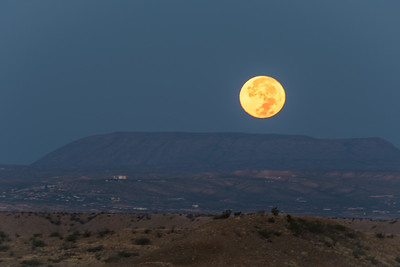 Supermoon rising over Terlingua, Texas at sunset.