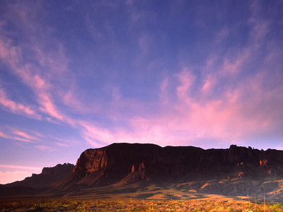 First rays of light catch the Chisos Mountains and desert, Big Bend National Park