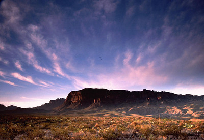 """This is Big Bend National Park at dawn.  This is the Chisos Mountains looking south from the main highway.  The """"Basin"""" is on the other side of that big rock."""