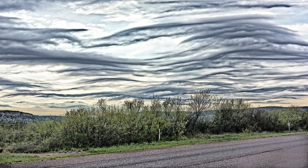 Interesting cloud formation affected by the wind and mountains.