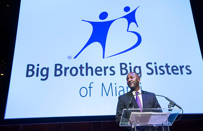 "Big Brothers Big Sisters of Miami Little's graduation ceremony and scholarship awards June 9th, 2016 in the Knight Concert Hall at the Adrienne Arsht Center in Miami. (Photo by MagicalPhotos / Mitchell Zachs)  Here is full press release: Carnival Foundation and Big Brothers Big Sisters of Miami Celebrate Grand Opening of $5 Million Carnival Center for Excellence  Carnival's gift represents the largest corporate donation  ever to any affiliate chapter of the national BBBS organization  MIAMI (April 4, 2016) — Carnival Foundation, the philanthropic arm of Carnival Corporation, and Big Brothers Big Sisters of Miami today celebrated the grand opening of the new BBBS headquarters, the Carnival Center for Excellence. The center was made possible through a $5 million gift from Carnival Foundation, the largest corporate gift ever bestowed on the Miami chapter and the largest ever provided to any local affiliate chapter of the national nonprofit youth mentoring organization. In addition, the National Basketball Association's Miami HEAT Charitable Fund donated a $350,000 state-of-the-art Miami HEAT Big Fitness Room to the facility to promote health and wellness to BBBS participants.  A ribbon-cutting ceremony and news conference took place at the facility at 550 NW LeJeune Road in Miami. The event featured executives of Carnival, BBBS and the Miami HEAT as well as local elected officials and student essay contest scholarship winners, and tours of the facility.   ""Carnival Corporation has been a longtime supporter of Big Brothers Big Sisters of Miami through Carnival Foundation and our Scholarship and Mentoring Program, and we are proud that the Carnival Center for Excellence bears our name,"" said Arnold Donald, CEO of Miami-based Carnival Corporation, the world's largest leisure-travel company. ""The facility provides a much-needed new headquarters for Big Brothers Big Sisters of Miami. Most importantly, the facility will help BBBS of Miami continue to have a profound and positive impact on the lives of young people in South Florida for decades to come.""  At the ceremony Carnival Foundation Executive Director Linda Coll announced the winners of a recent essay contest in which students described how their mentors have positively impacted their lives. A total of $30,000 was awarded in scholarships and educational resources on behalf of Carnival Foundation to three high school and two middle school scholarship winners. Winners also received laptop computers.  The winners of the contest were 12th grader Crystal Proctor from Miami Carol City Senior High School, 12th grader Martin Menard from North Miami Senior High School, 10th grader Amaya King from Miami Lakes Educational, eighth grader Stephen Kelly from Miami Lakes Middle School and sixth grader Ladarrius Blackman from The SEED School of Miami.  ""The opening of the Carnival Center for Excellence marks a new era for Big Brothers Big Sisters of Miami, enabling us to provide more facilities, services and assistance to local children and families than ever before,"" said Lydia Muniz, president and CEO of the Miami BBBS chapter. ""The Carnival Center for Excellence will be an inspired hub of mentoring and innovative creative services for local kids, families and volunteers, as well as the general public, and we thank all those partners who are making this possible.""  ""It's a privilege for the Miami HEAT Charitable Fund to join Carnival Foundation and Big Brothers Big Sisters of Miami in providing students with access to tools for immediate and future success,"" said Eric Woolworth, president of the HEAT Group's Business Operations. ""The Miami HEAT Big Fitness Room offers students a space in which to exercise and socialize, and a positive setting that encourages hard work and dedication.""  The Carnival Center for Excellence provides ample custom-designed space to support ongoing mentoring and educational activities for BBBS beneficiaries, known as ""Littles."" The facility will house more than 50 BBBS staff members, as well an array of much-needed new tools and services. The center will include a ""You Media"" creative area for music, video and creative digital learning; a computer lab; space for homework and tutoring; life-skill classes; continuing education; and the Miami HEAT Big Fitness Room with exercise equipment, free weights and activity space. The Trish and Dan Bell Enrollment and Matching Center will house the organization's core mentor-student matching function. The Kennedy Family Resource Room and the Bank of America Career Resource Room will provide services to help families and children plan for their future. The Gorson Family Wing on the second floor will serve as the main BBBS boardroom for key leadership strategy meetings and gatherings.   Additional services will be phased in, and tutoring and family classes will be introduced during the first year of operation in collaboration with several corporate and nonprofit partners.   The building is conveniently located on a major thoroughfare with access to public transportation and free ground-level parking.   Carnival Foundation's signature initiative, the Carnival Scholarship and Mentoring Program, pairs Carnival Corporation employees with South Florida high school students matched by BBBS. Currently, 100 of the company's management team members mentor 100 Miami-Dade County high school students through the in-the-workplace program sponsored by Carnival Corporation in partnership with BBBS.   The program also awards four-year college scholarships to 15 participating students every year. During the past 13 years, Carnival Foundation has purchased Project STARS scholarships representing a collective value of more than $2.1 million. Since 2010, 90 scholarships have been awarded, and the first group of Carnival Scholarship recipients graduated college in 2014.  # # #  About Carnival Foundation Carnival Foundation is dedicated to creating positive change through empowering youth, enhancing education and strengthening families in the communities where Carnival Corporation employees live and work. Through monetary and in-kind donations, innovative philanthropic programs, employee fundraisers and hands-on volunteer initiatives, the foundation supports hundreds of organizations annually with primary funding focused in the areas of the arts, human needs, education and health.  Carnival Foundation partners include National YoungArts Foundation, New World Symphony, Florida International University, Buoniconti Fund to Cure Paralysis, Best Buddies International, The Nature Conservancy, Dress for Success Worldwide, United Negro College Fund, Hispanic Scholarship Fund and Feeding South Florida. Its website is www.carnivalfoundation.com.  About Big Brothers Big Sisters of Miami Big Brothers Big Sisters is a donor and volunteer supported organization that awakens new opportunities in the lives of at-risk children through supportive adult mentor relationships – one child and one afternoon at a time.  For more information, visit www.wementor.org or call 305-644-0066.  About the Miami HEAT Charitable Fund Established in 1997, the Miami HEAT Charitable Fund supports programs for the betterment of at-risk families in South Florida. Beneficiaries include SafeSpace, a domestic violence shelter for women and children, the Jackson Memorial Foundation's Guardian Angels and Holtz Children's Hospital, and Home Strong. The Miami HEAT Charitable Fund also provides educational scholarships for high school seniors and partners with inner-city elementary schools to fund the HEAT Academy, which provides after-school tutoring and mentoring programs. Through these initiatives, the Miami HEAT Charitable Fund continues to inspire the youth of South Florida to envision their dreams and achieve their goals.   MEDIA CONTACTS: Carnival Foundation NewmanPR, 305-461-3300 Buck Banks, buck@newmanpr.com Julie Ellis, julie@newmanpr.com  Big Brothers Big Sisters of Miami Roar Media, 305-403-2080 Julia Wakefield, julia@roarmedia.com Andi Phillips-Lopez, andi@roarmedia.com  Miami HEAT Lorenzo Butler, lbutler@heat.com"