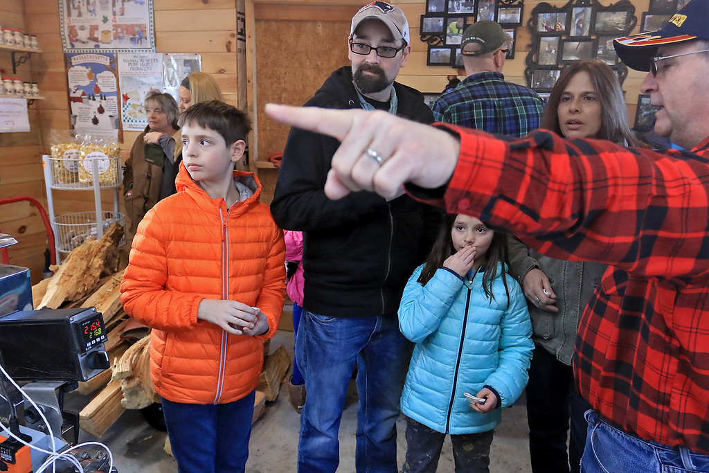 . Big Head Fred\'s Maple Syrup in Leominster was boiling syrup at their sugarhouse for the first time this year on Sunday, March 3, 2019. Sam Lazuka, 11, Ava Lazuka, 8, thier dad Blair and aunt Laura Williams listen to Norman Ducharme as he talks about how they make the maple syrup. SENTINEL & ENTERPRISE/JOHN LOVE