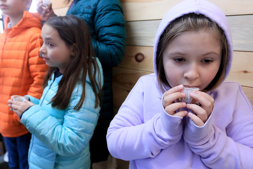 . Big Head Fred\'s Maple Syrup in Leominster was boiling syrup at their sugarhouse for the first time this year on Sunday, March 3, 2019. During the first boiling of the sesaon Owner Fred Lake let everyone that came try a sample of the maple syrup. Blowing on it to cool it down before tring it is Alexis yates, 7, from Ayer. SENTINEL & ENTERPRISE/JOHN LOVE