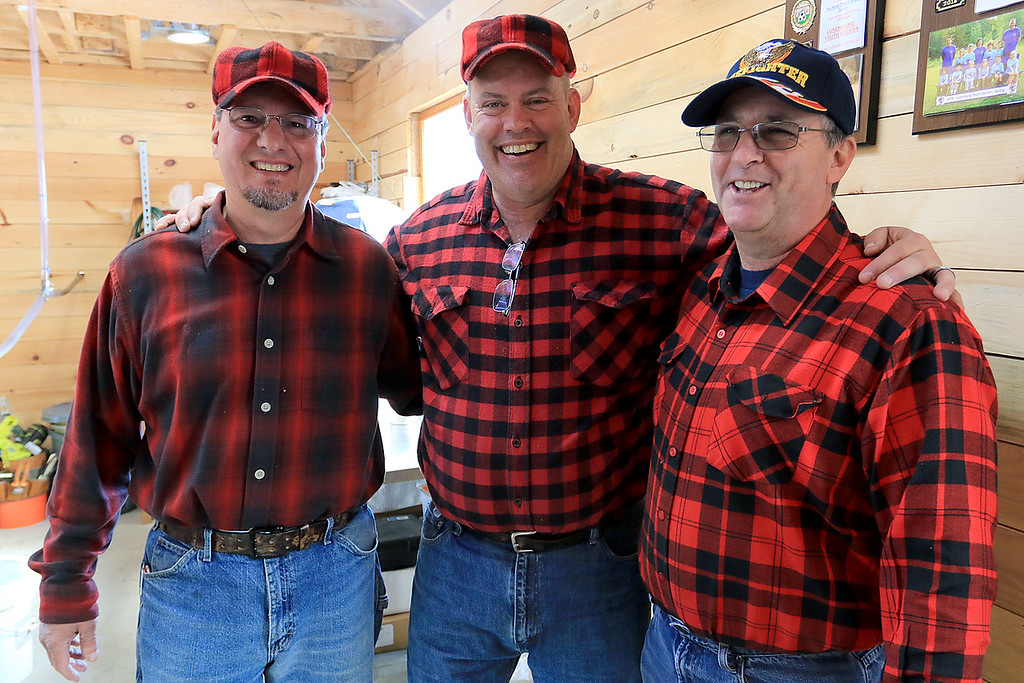 . Big Head Fred\'s Maple Syrup in Leominster was boiling syrup at their sugarhouse for the first time this year on Sunday, March 3, 2019. Owner Fred Lake, center, stands with his employees David Thibodeau, left, and Norman Ducharme at the sugarhouse during their first boiling of the season.  SENTINEL & ENTERPRISE/JOHN LOVE