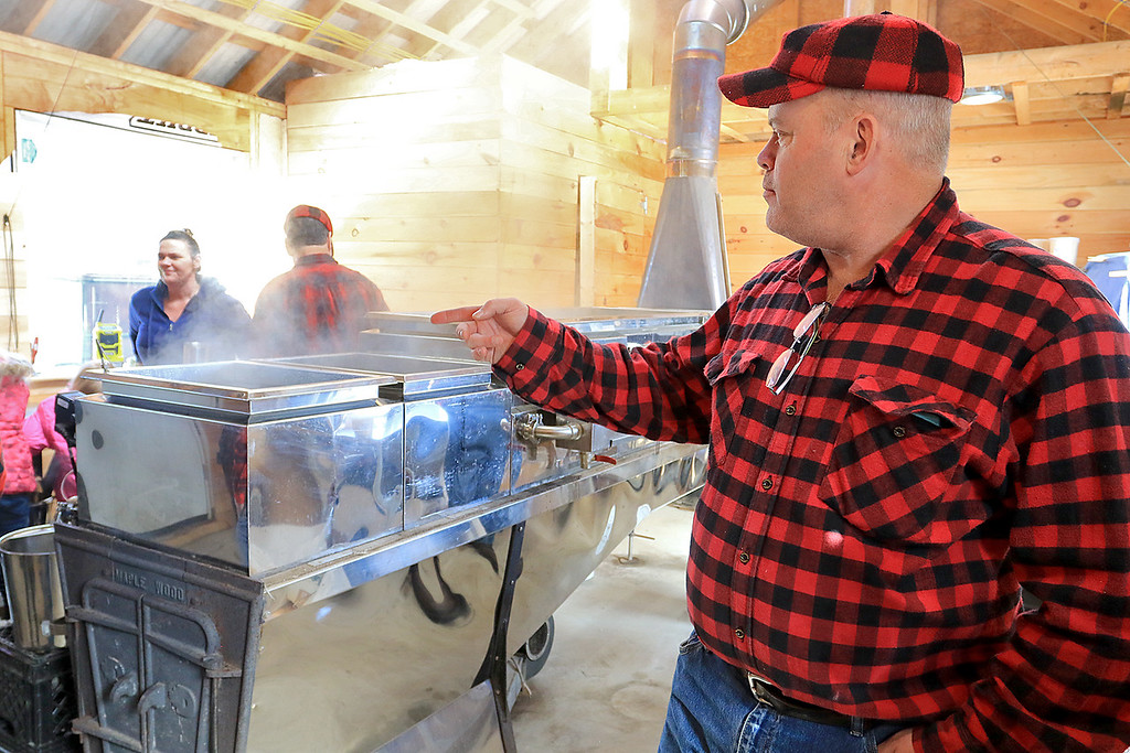 . Big Head Fred\'s Maple Syrup in Leominster was boiling syrup at their sugarhouse for the first time this year on Sunday, March 3, 2019. Fred\'s makes maple kettle corn, maple candy, maple as well syrup. Owner Fred Lake talks about the process to the many customers who came to see him on Sunday. SENTINEL & ENTERPRISE/JOHN LOVE