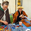 Members of the Barony of Black Diamond weaving