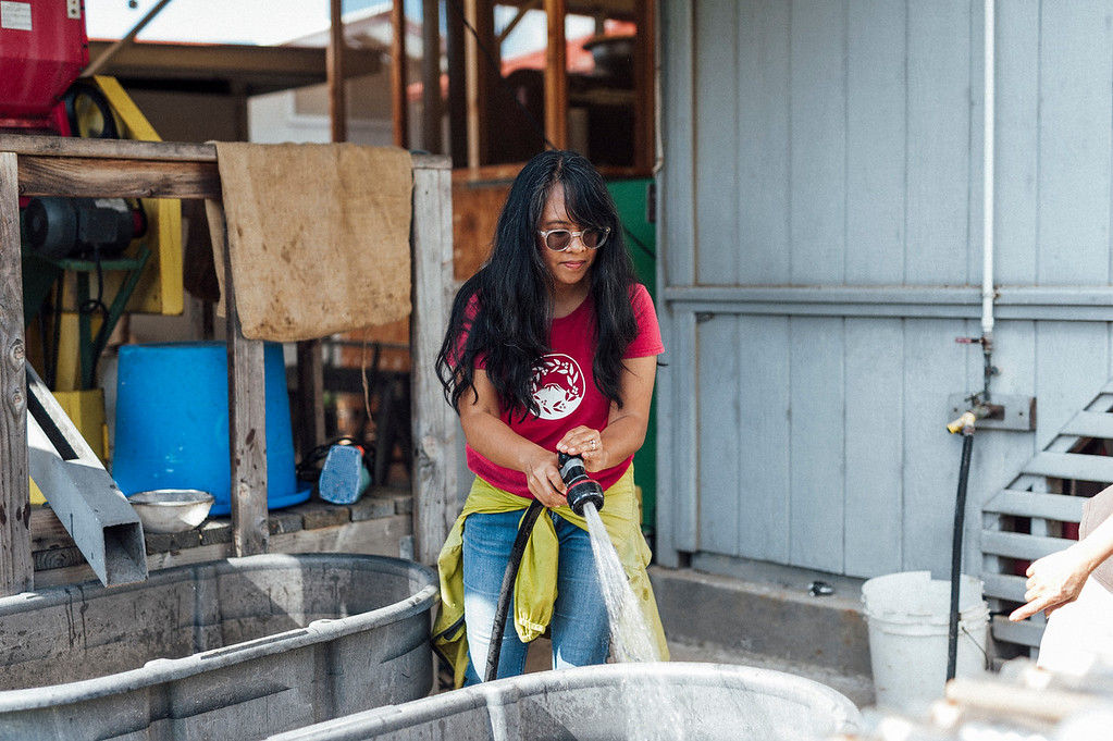 Joan Obra of Rusty's Hawaiian Coffee rinses beans outside her mother's Pahala home where they process their coffee. Every part of the coffee process at Rusty's Hawaiian is hand done.