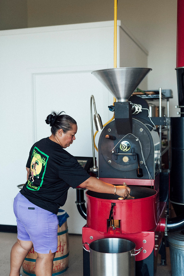 Master roaster and licensed Q grader Laura Ross roasts a batch of coffee at Hula Daddy Kona Coffee.