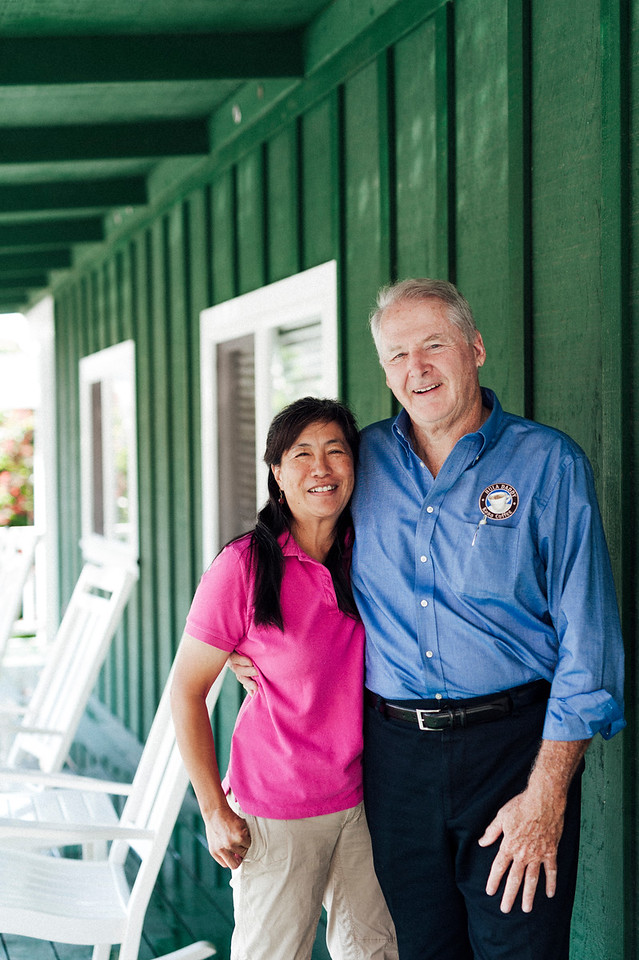 Hula Daddy Kona Coffee owners Karen and Lee Paterson outside their farm.