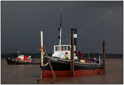 The Kerne being winched on to the slipway with the weather moving in.