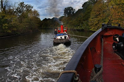 Slight problems with a sandbank. The Kerne being towed off the bank by the Kennet that followed her from Acton Bridge.