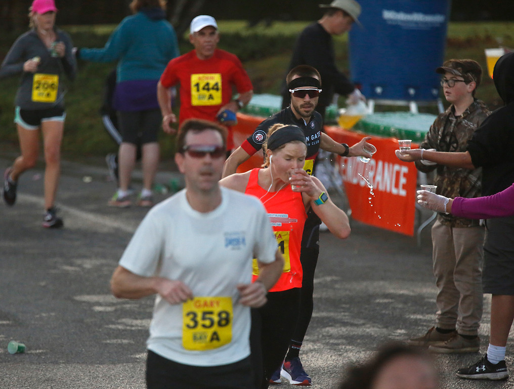 . Runners hydrate near Point Pinos during the Monterey Bay Half Marathon in Pacific Grove, Calif. on Sunday November 12, 2017. (David Royal/Herald Correspondent)