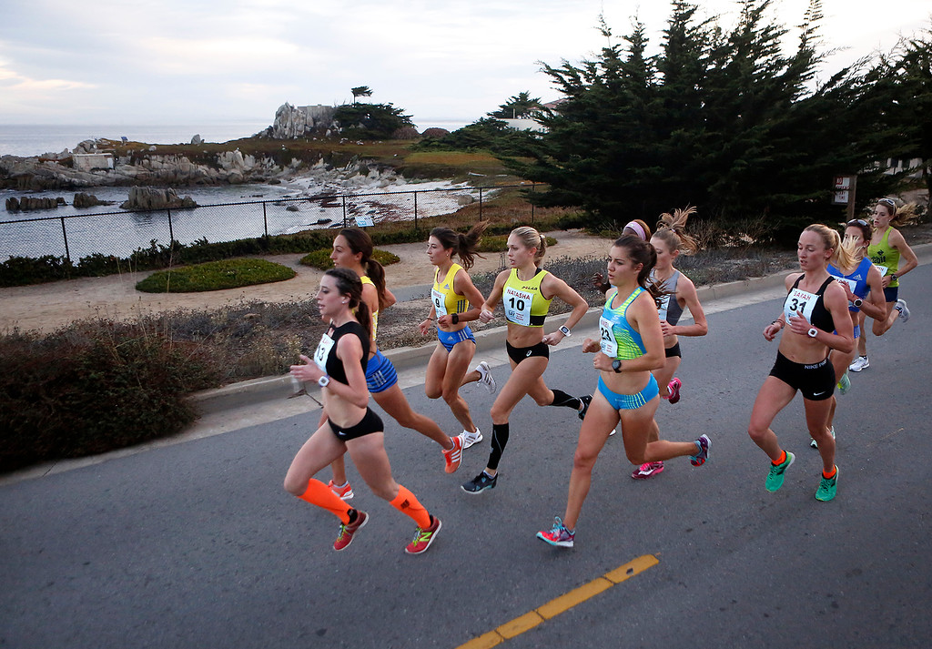 . The pack of lead female runners pass by Hopkins Marine Station during the Monterey Bay Half Marathon in Pacific Grove, Calif. on Sunday November 12, 2017. (David Royal/Herald Correspondent)