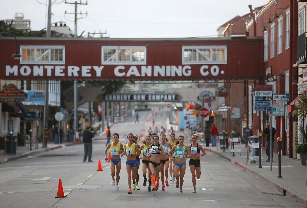 . Female lead runners run along Cannery Row during the Monterey Bay Half Marathon in Monterey, Calif. on Sunday November 12, 2017. (David Royal/Herald Correspondent)