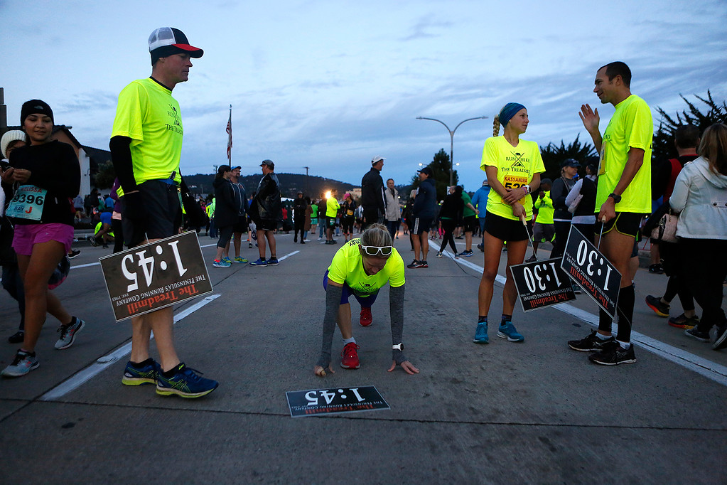 . Pace runners Shane Buzza, left, Jaymee Marty, Kassandra Spitler and Adam Roach ready themselves before the start of the Monterey Bay Half Marathon in Monterey, Calif. on Sunday November 12, 2017. (David Royal/Herald Correspondent)